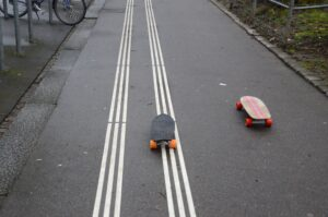 Two runaway skateboards
