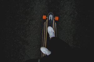 Top down view of a person standing on an rc longboard
